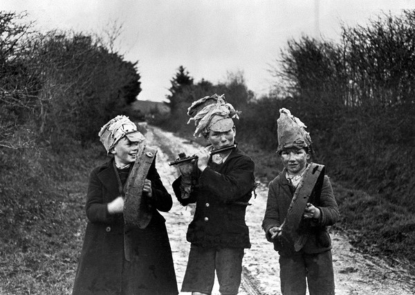 St Stephen's Day, Wren Boys : Three wren boys in road, Athea, Co. Limerick. Image copyright University College Dublin, National University of Ireland, Dublin.
